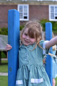 A girl on the play equipment