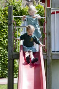 Young girls on a slide